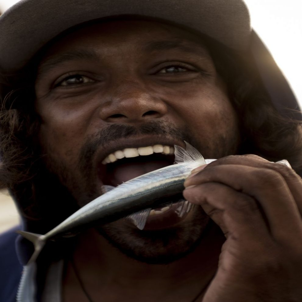 Local fisherman proving the freshness of the catch
