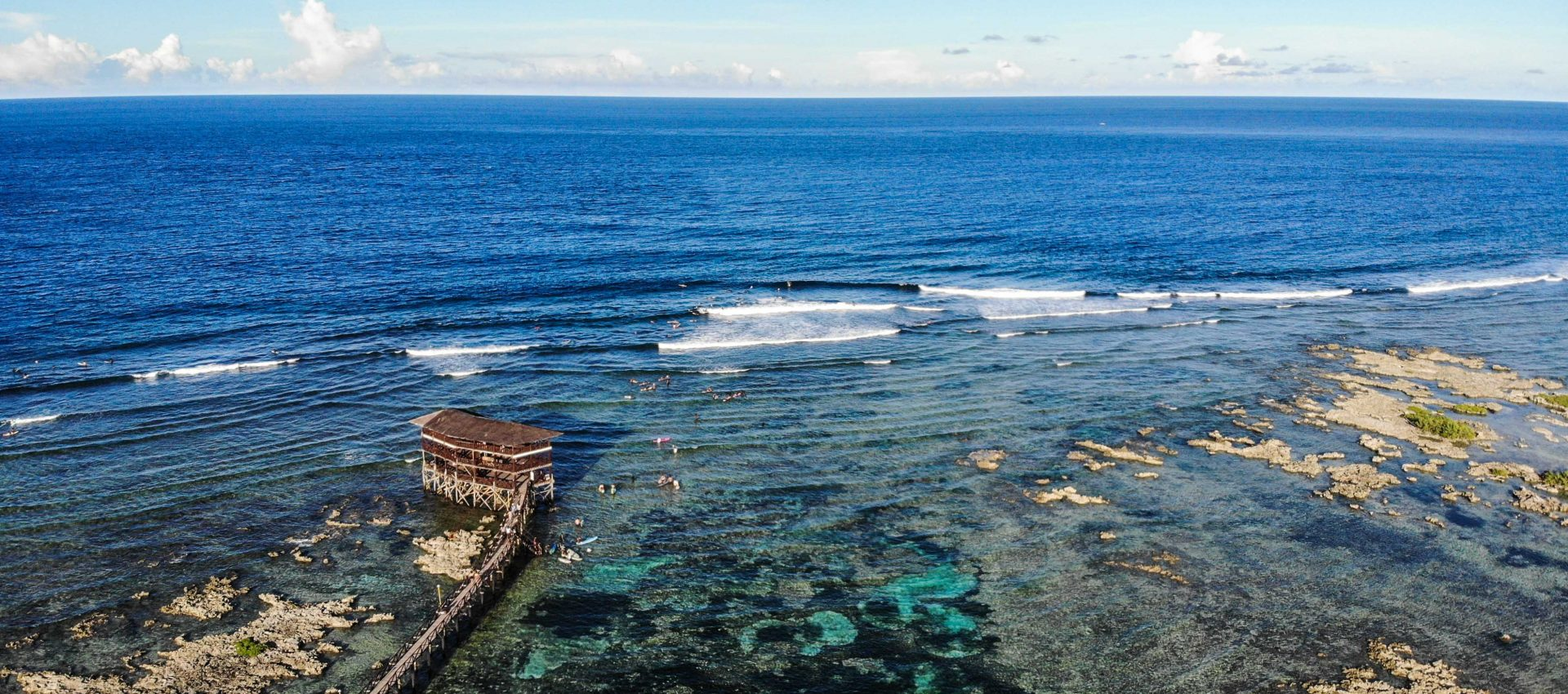 The famous Cloud 9 surf tower is the best spot to check out some professional surfing.
