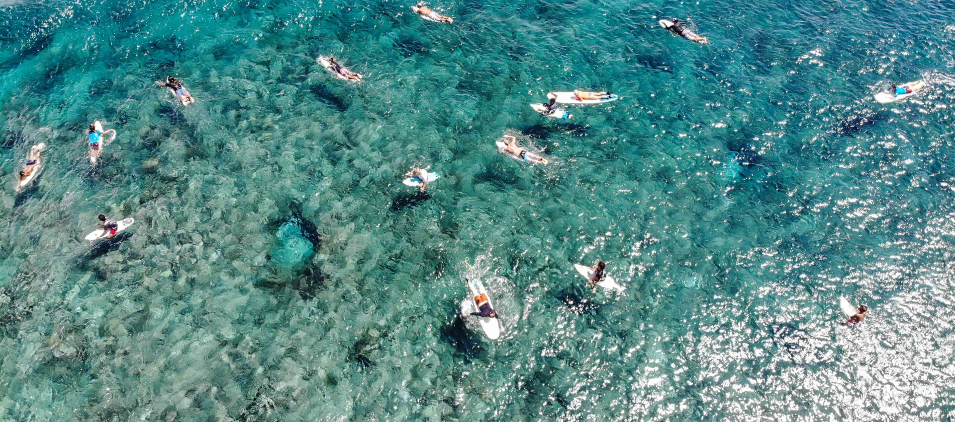 Birds eye view of our group enjoying the warm crystal clear water and the perfectly smooth waves.