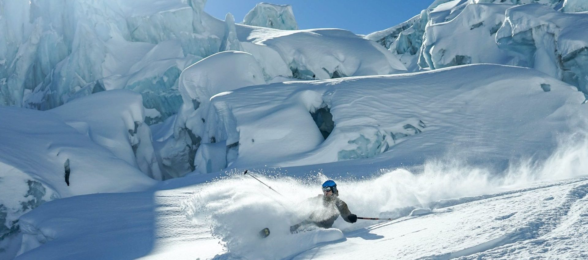Powder turns and face shots with the best majestic glacier backdrop.