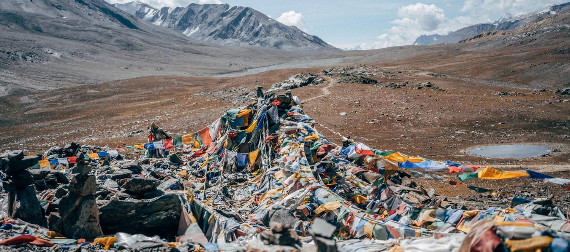 The mantras of the prayer flags are carried by the wind, spreading peace, compassion, strength, and wisdom.