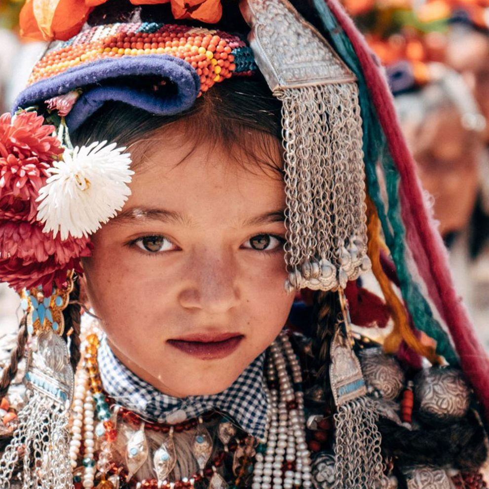 An Aryan girl in her hand made traditional dress and headpiece.