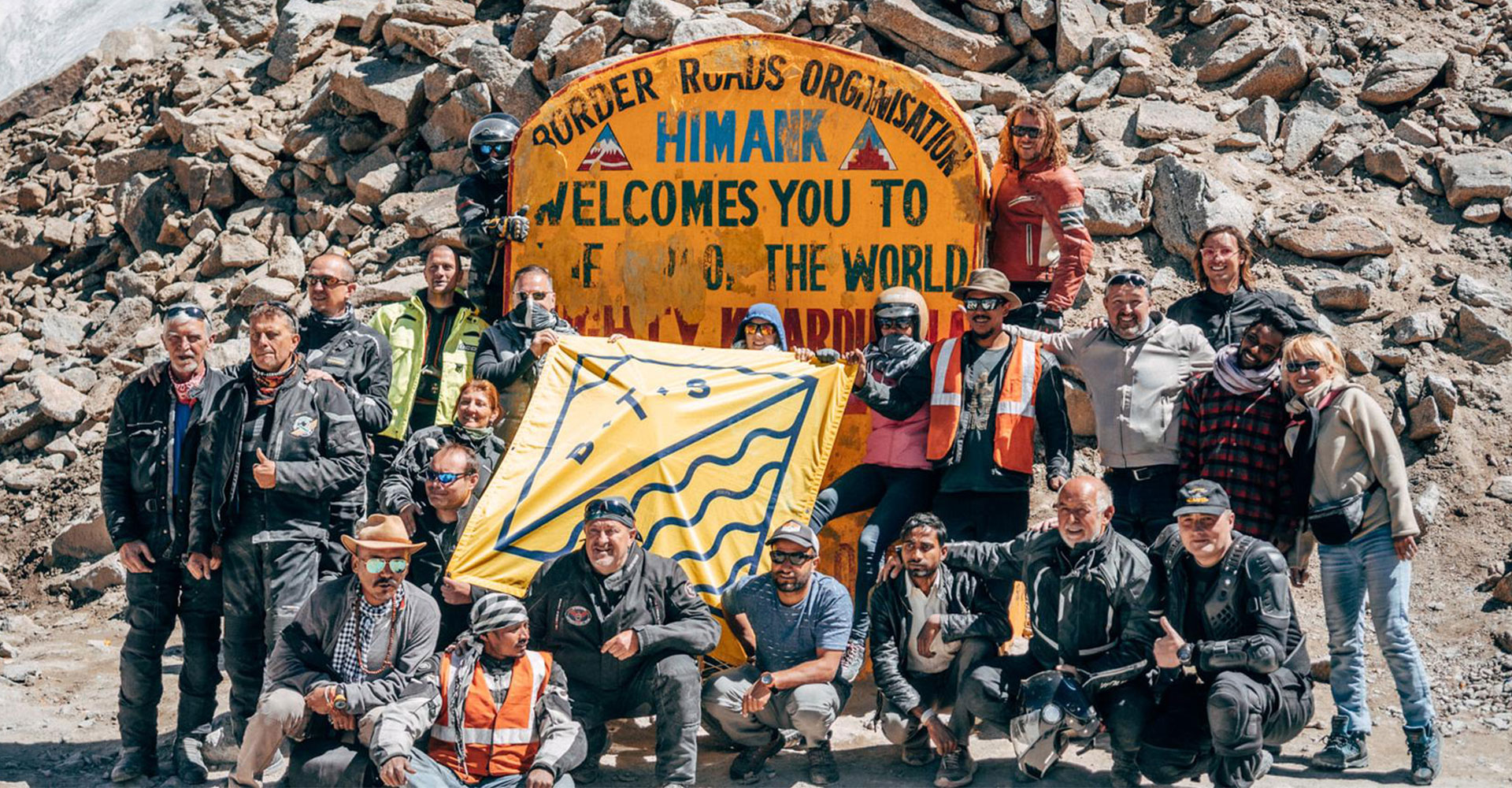 Happy BTS team on the summit of the world's highest motorable pass, the mighty Khardung La 5,359 meters above sea level.