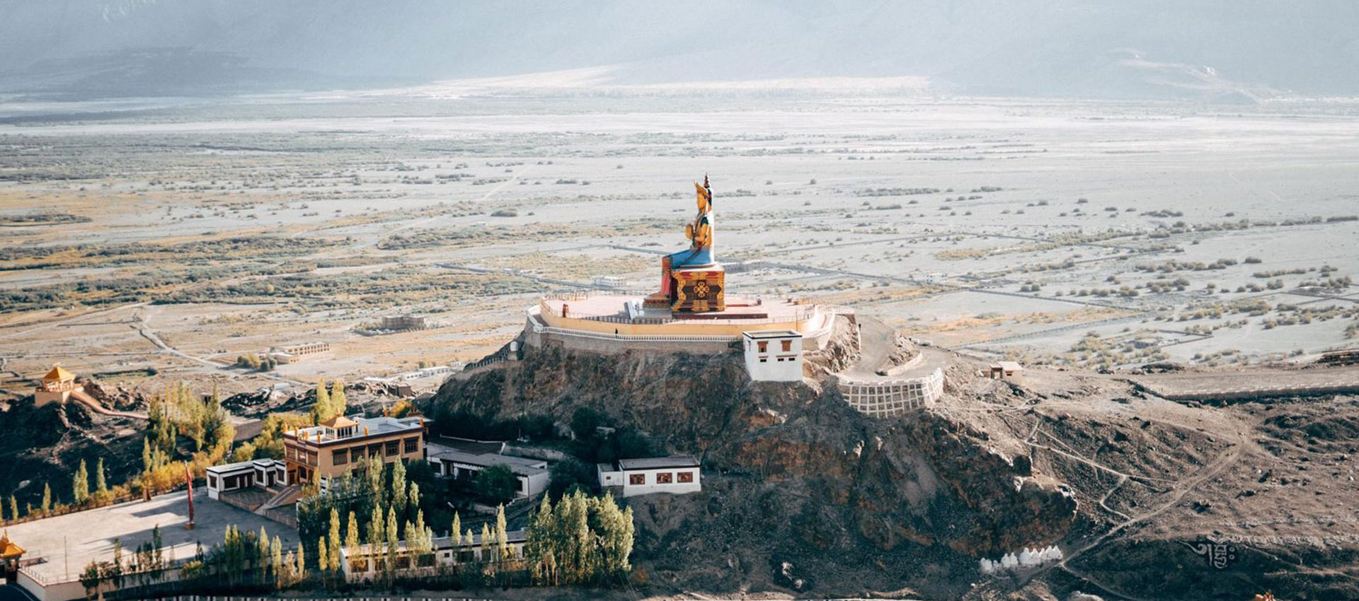 The impressive 32 meter tall Buddha statue of the Diskit monastery facing the Pakistani border spreads peace throughout the Valley.