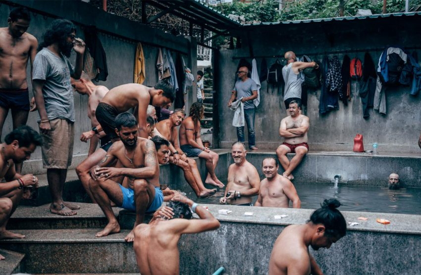 After a hard day of riding the group is relaxing in the public hot thermal bath of Manali while chatting with the locals.