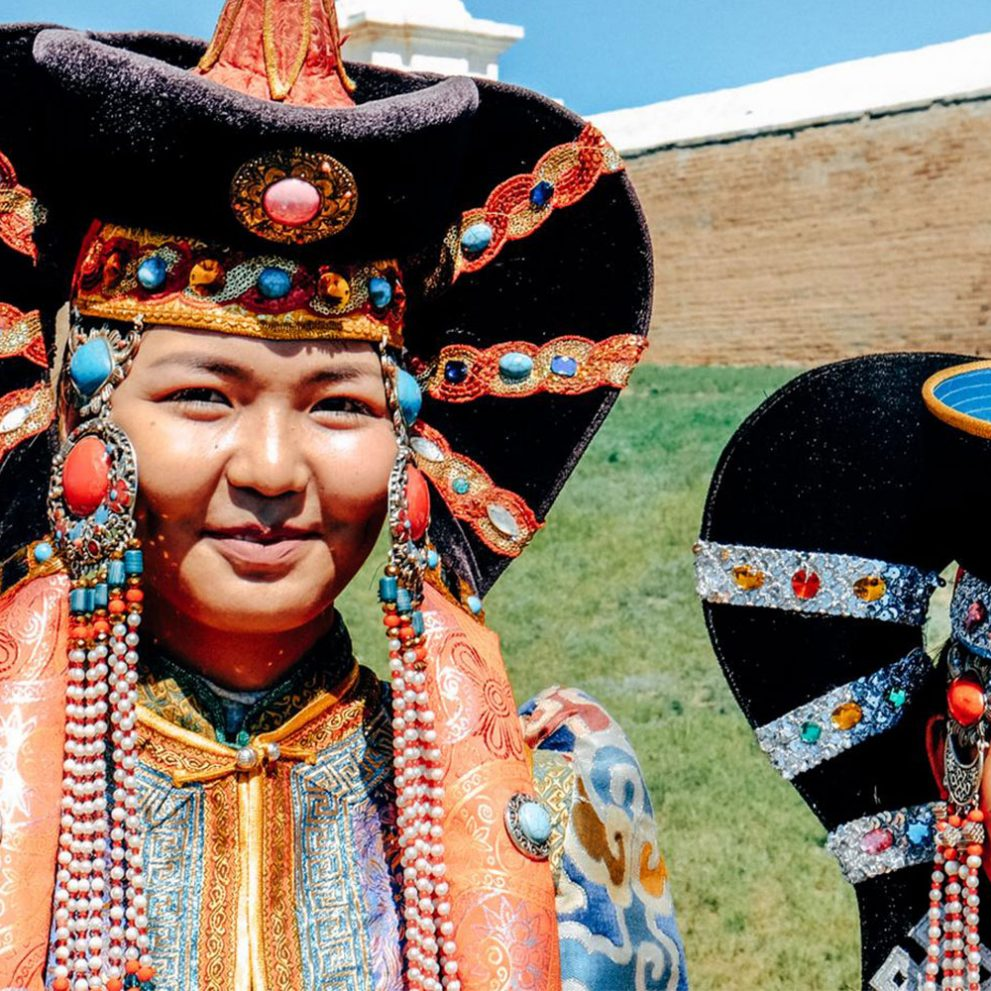 The main element of a headdress is a special hairstyle, designed to mimic cow's horns, cows symbolizes freedom in Mongolia.