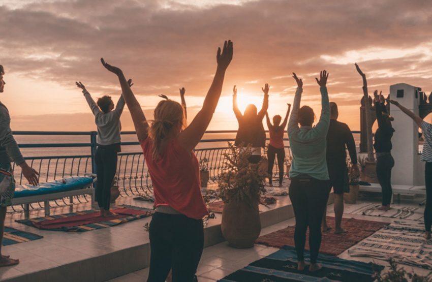 A sunset yoga session on our rooftop terrace is the best recovery from all the surfing.