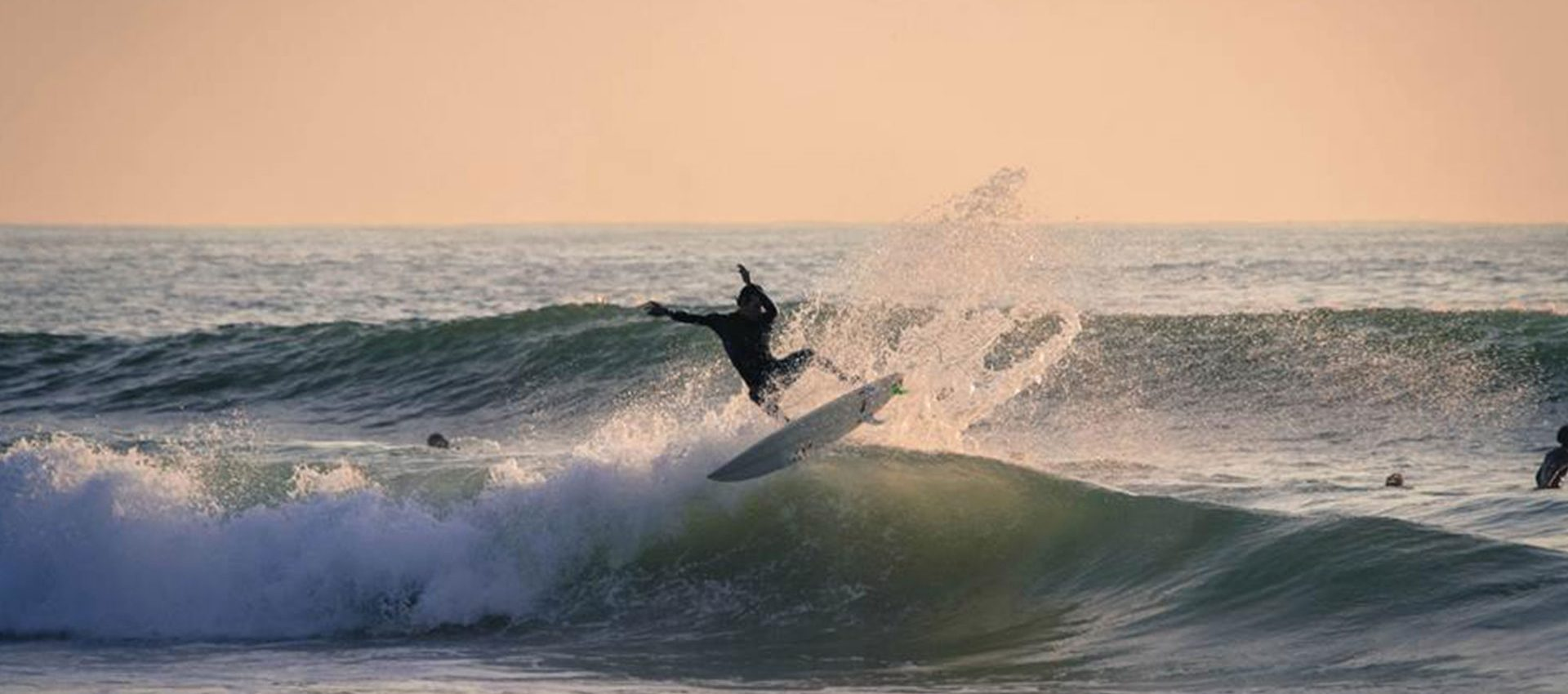 A big splash on the lip of this beautiful wave is the perfect way to end a sunset surf session.