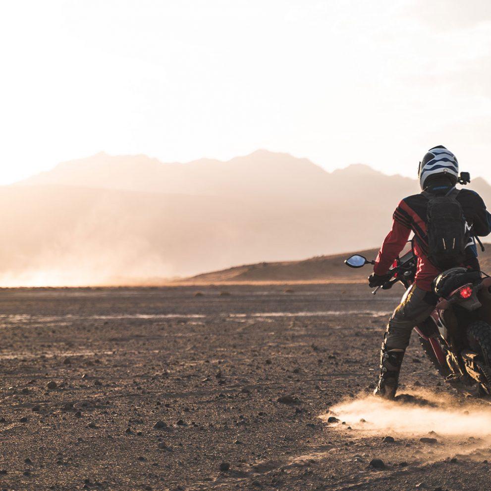 Riding in vast wilderness.