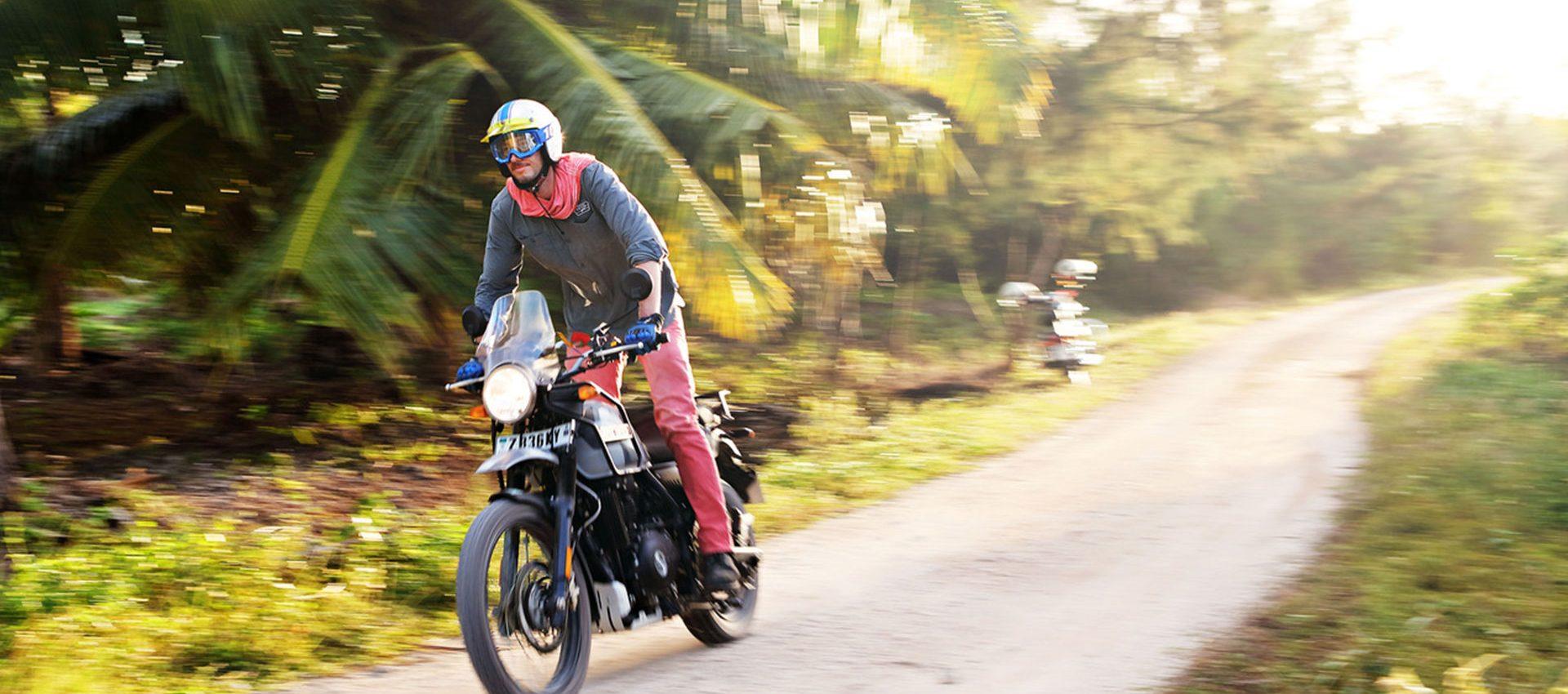 Riding between palm trees in Zanzibar.